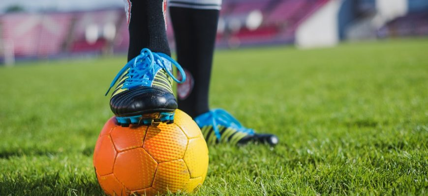 soccer-player-with-foot-on-ball